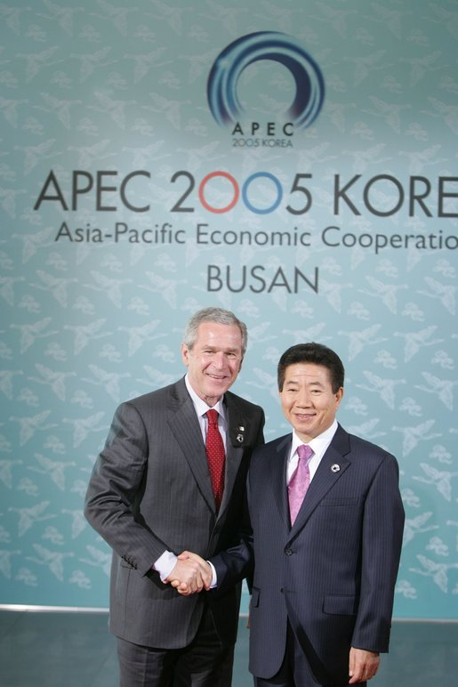 Arrives at BEXCO Facility for APEC Leader Retreat met by President of the Republic of South Korea. /George W. Bush White House