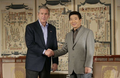 Meeting with the President of the Republic of South Korea. President George W. Bush and Korea President Moo Hyun Roh exchange handshakes Thursday, Nov. 17, 2005, after their meeting at the Hotel Hyundai in Gyeongju, Korea. White House photo by Eric Draper